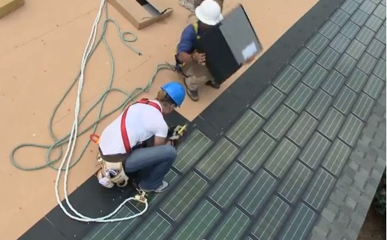 Men Installing Solar Roof Shingles